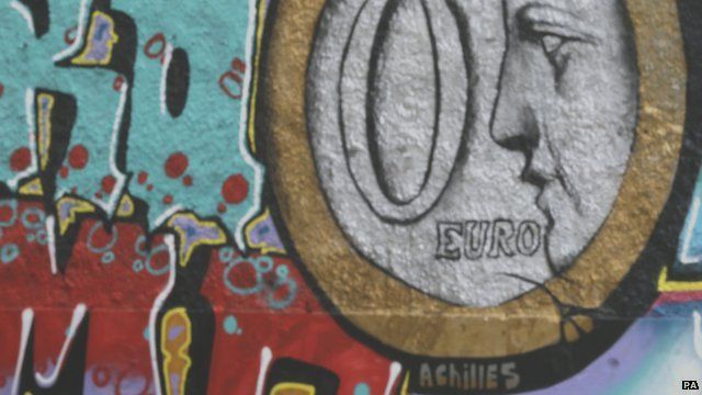 "Close up of Greek graffiti showing image of a ""zero"" euro coin"