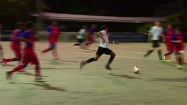 Men playing football in Georgetown