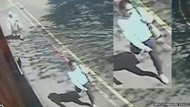 Image of CCTV footage showing a woman walking along a pavement