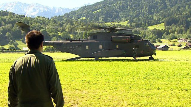 The helicopter which transports the journalists to the G7