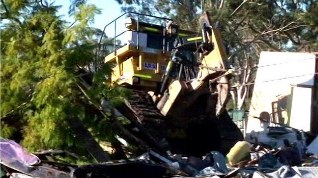 Bulldozer being towed