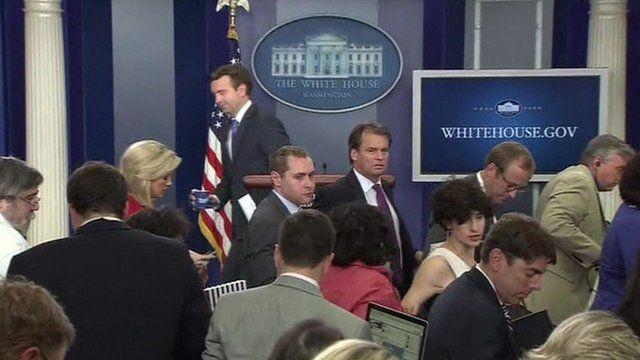 Reporters leave press room
