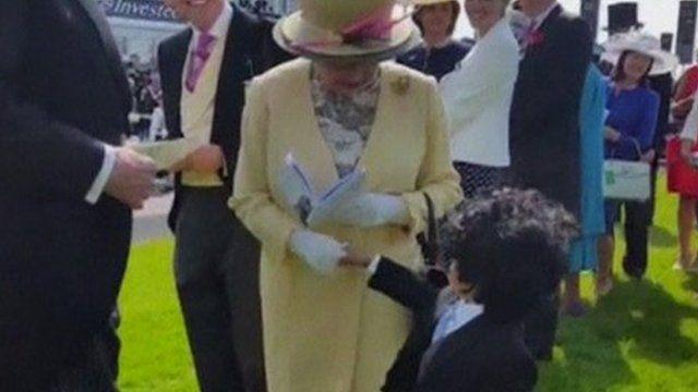 Queen meeting little boy