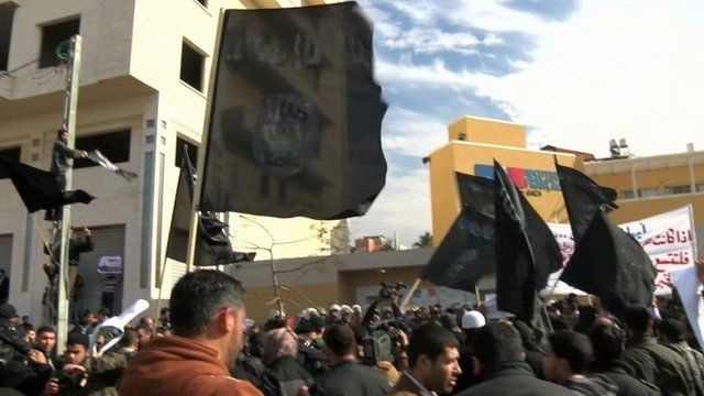 IS Flags fly at a Gaza Charlie Hebdo cartoon protests in early 2015