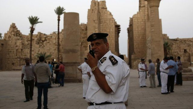 Egyptian security officials stand guard at the Karnak Temple in Luxor