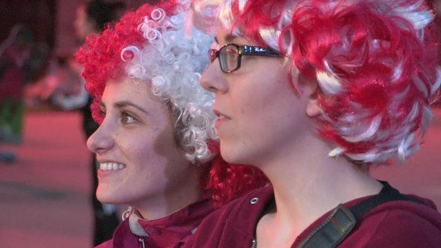Two female Canadian Woman's football fans in wigs