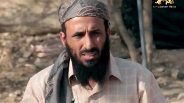Grab from video of AQAP chief Nasir al-Wuhayshi allegedly addressing scores of jihadists at an undisclosed location in Yemen