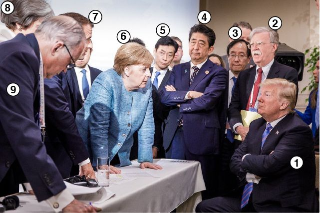 Leaders captured in deep conversation with Donald Trump