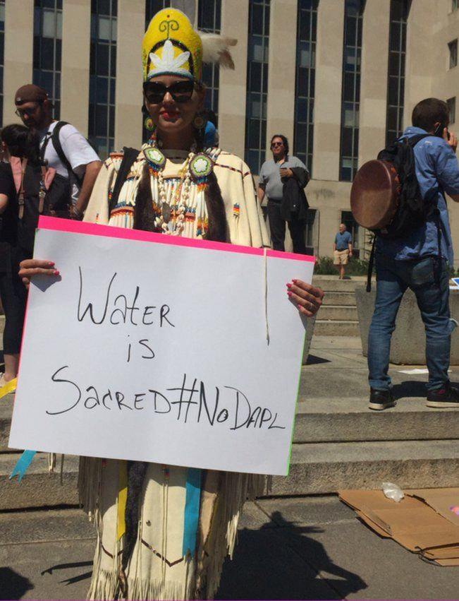 Activist Kim Sierra stands outside the US District Court in Washington to show her support for the Standing Rock Sioux tribe.