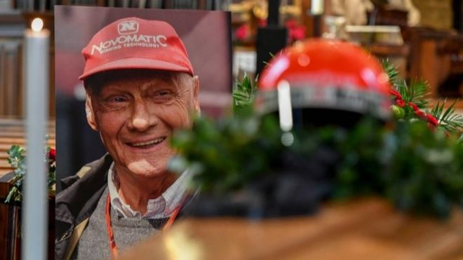 Niki Lauda's crash helmet is put on his coffin next to a picture of the driver at St Stephen's cathedral in Vienna, Austria. Photo: 29 May 2019