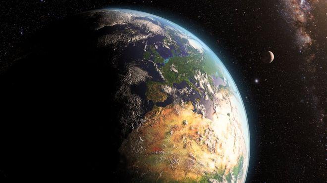 Planeta terra com a lua e as estrelas ao fundo