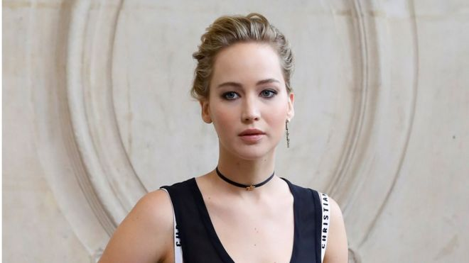 US actress Jennifer Lawrence poses before the Christian Dior 2017 Spring/Summer ready-to-wear collection fashion show, on September 30, 2016 in Paris.