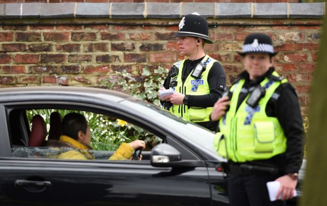 "Police officers from North Yorkshire Police stop motorists in cars to check that their travel is ""essential"""