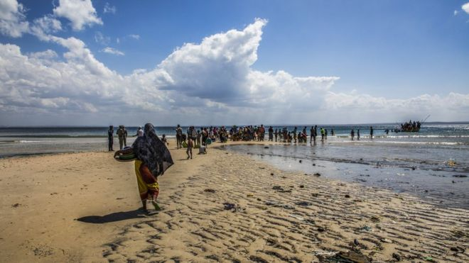 File photo of people fleeing on a beach in northern Mozambique