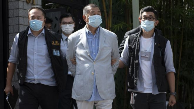 Jimmy Lai taken by police from his house