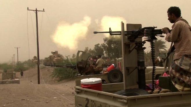 Houthi rebels fire a machine gun outside Hudaydah