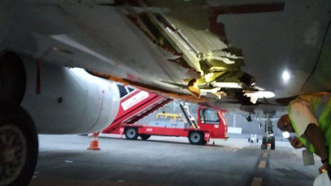 Air India plane hits wall on take-off - BBC News