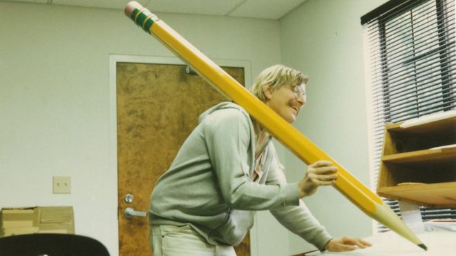 Mark holds a giant pencil during production of Return to Neverland short