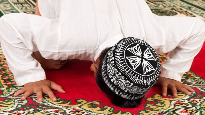 Young Muslim praying