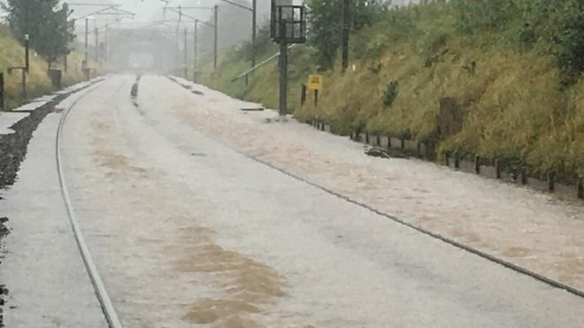 Flooding closes West Coast mainline between England and Scotland