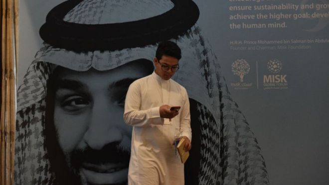 Economic conference delegate in front of a portrait of Saudi Crown Prince Mohammed bin Salman in Riyadh (file photo)