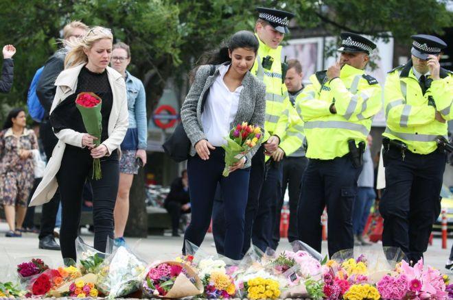 People lay flowers near London Bridge station following Saturday's terror attack.
