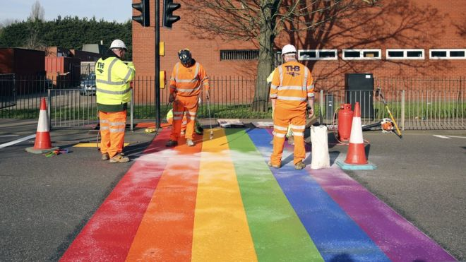 Rainbow crossing and highway workers