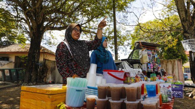 Siti Ain e sua mãe