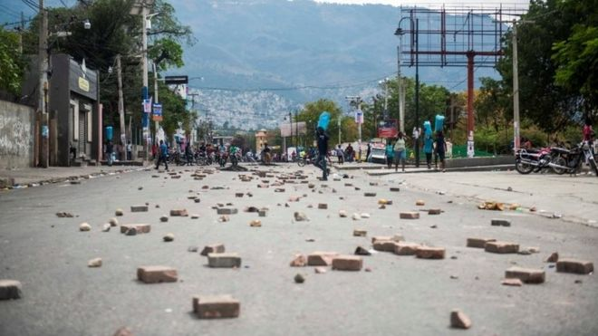 Protesters block the streets leading to the house of the President of Haiti, Jovenel Moise, during a new day of protests in Port-au-Prince, Haiti, 24 February 2020