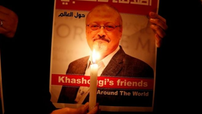 A demonstrator holds a poster with a picture of Saudi journalist Jamal Khashoggi outside the Saudi Arabia consulate in Istanbul,