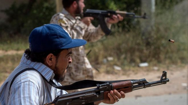 Fighters loyal to the internationally recognised Government of National Accord (GNA) fire their weapons during clashes with forces loyal to strongman Khalifa Haftar south of the capital Tripoli's suburb of Ain Zara, on April 25, 2019.