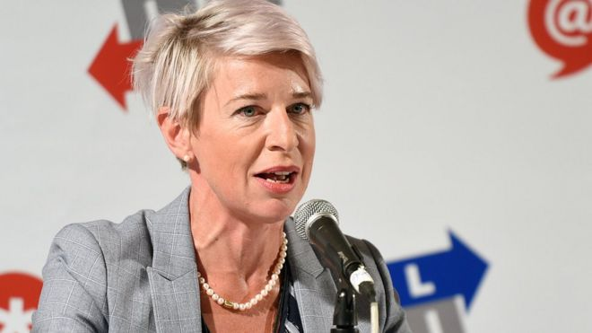 Katie Hopkins is seen sitting in front of a microphone