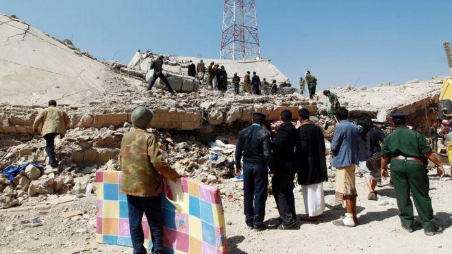 Aftermath of air strike on police headquarters in Yemen's capital, Sanaa (18 January 2016