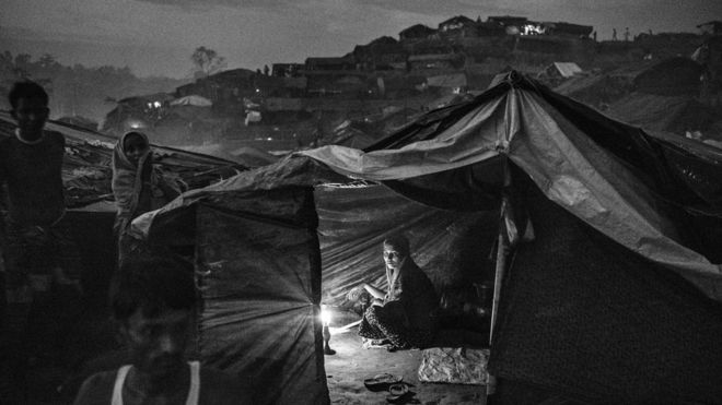 Rohingya woman sits in a tent in a refugee camp near Cox's Bazaar