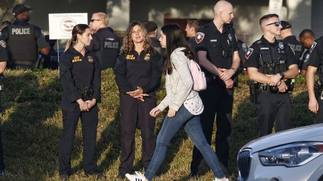 Marjory Stoneman Douglas High School staff, teachers and students return to school greeted by police and well wishers in Parkland, Florida on February 28, 2018