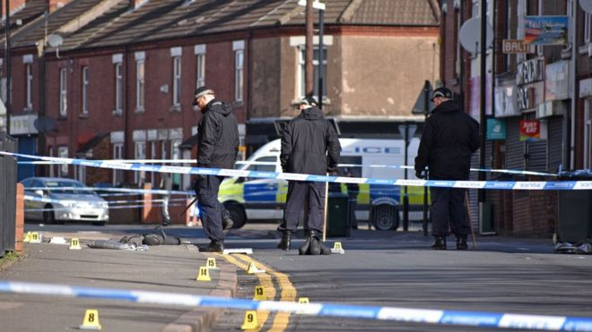 Police officers searching for evidence in Chandos Street, Coventry, after the death of a 16-year-old boy following a stabbing