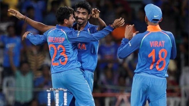 """Kuldeep Yadav, Jasprit Bumrah and team""""s captain Virat Kohli (L-R)"""