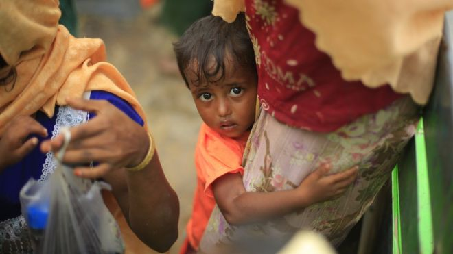 Two-year-old Hazera, confused and scared, holds on to her mother after reaching Bangladesh from Myanmar