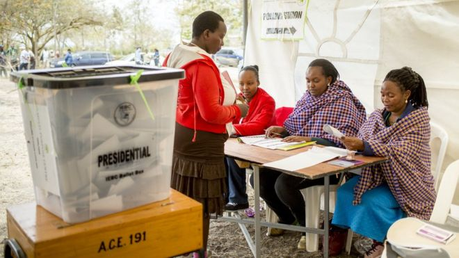 A Kenyan resident gets ready cast their ballot
