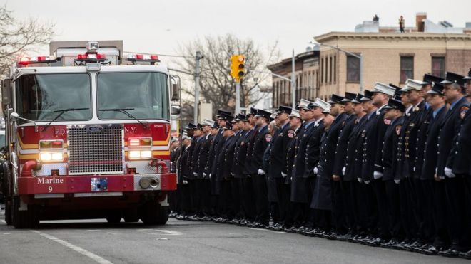 f7ca8947c63 Members of the New York City fire department (FDNY) escort the casket of  firefighter