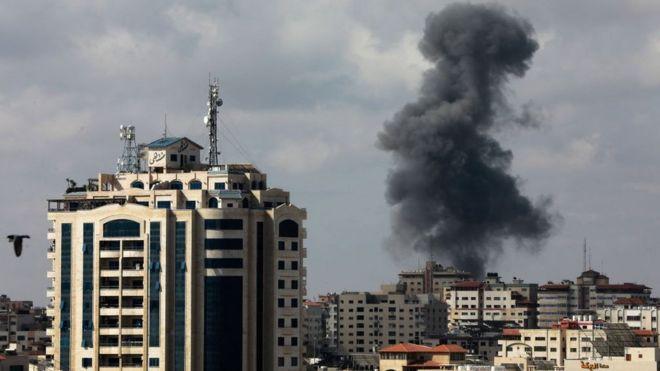 Smoke billows following an Israeli air strike on targets in Gaza City