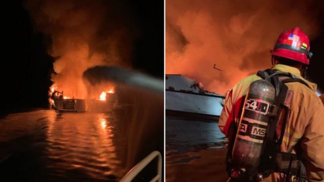 Fire-fighters attempt to board the boat which is in flames