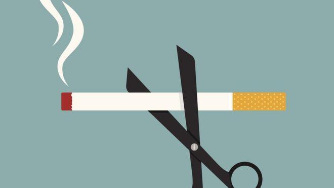 scissors cutting cigarette