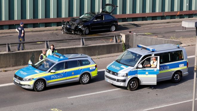 Police officers investigate the scene of a series of allegedly deliberate car crashes on highway A100 in Berlin, Germany, August 19, 2020