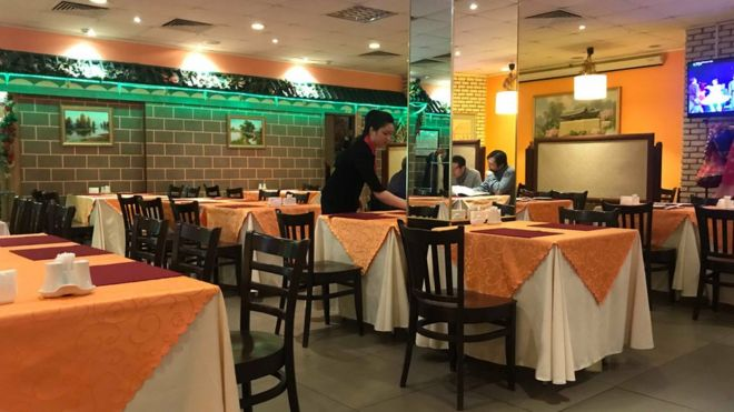 A waitress at a North Korean restaurant in Moscow