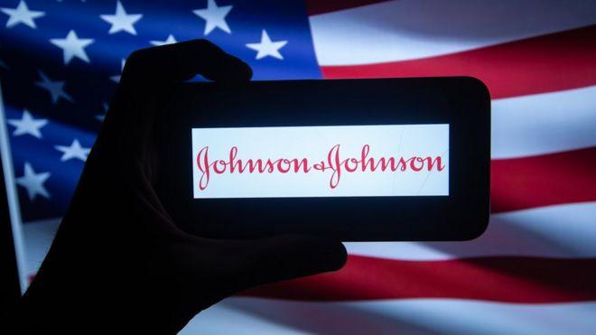 Johnson & Johnson logo in front of US flag