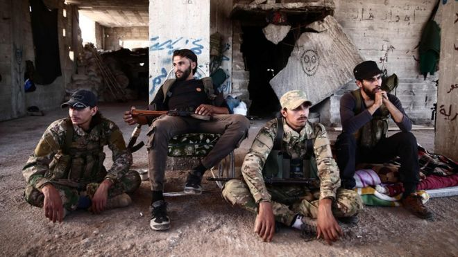 syria war rebels withdraw heavy weapons from idlib buffer zone