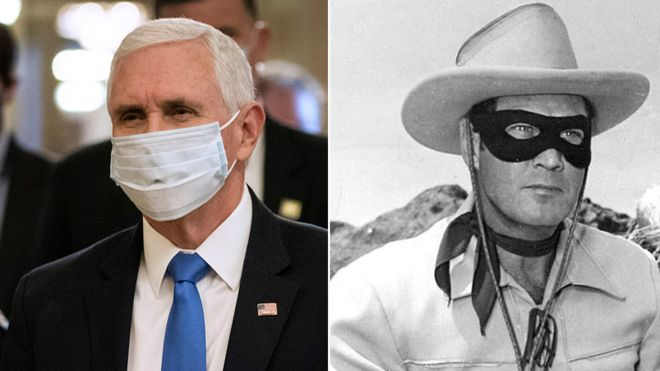 US Vice-President Mike Pence in a coronavirus face mask and the Lone Ranger in an eye mask
