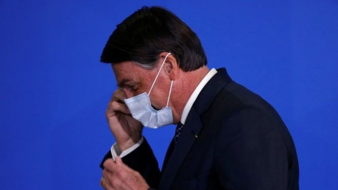 President Jair Bolsonaro reacts during a ceremony to launch a program to expand access to credit at the Planalto Palace in Brasilia, Brazil, August 19, 2020.