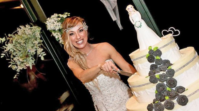 laura mesi who married herself cuts her wedding cake